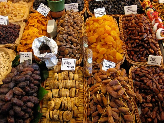 Various dried fruits on display in woven baskets
