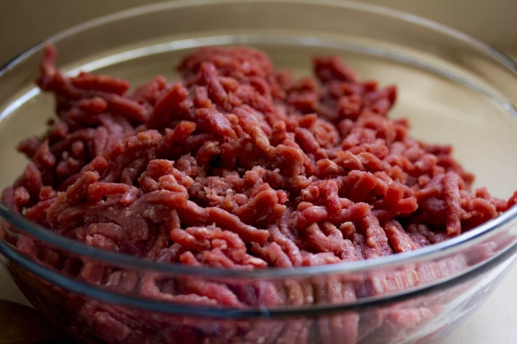 Glass bowl with raw ground beef