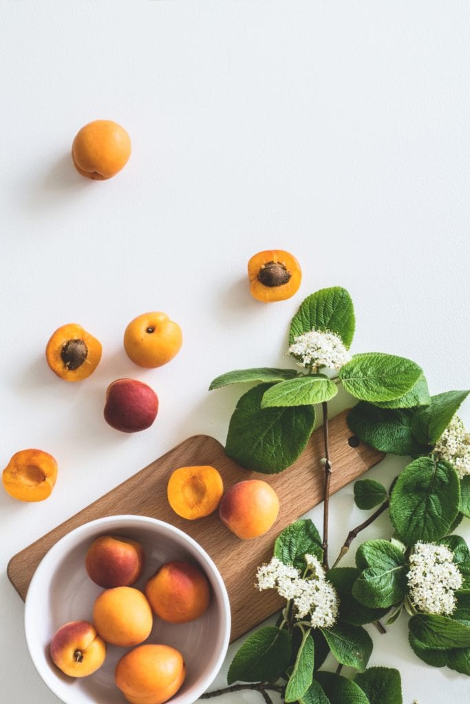Apricots and a cutting board