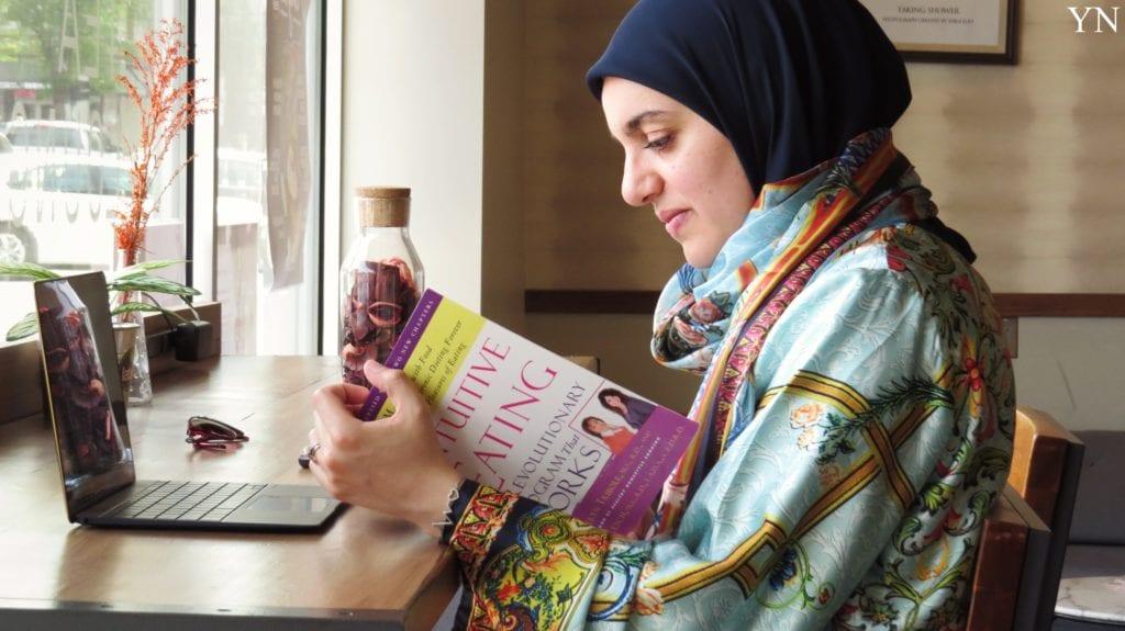Dua reading an educational nutrition book