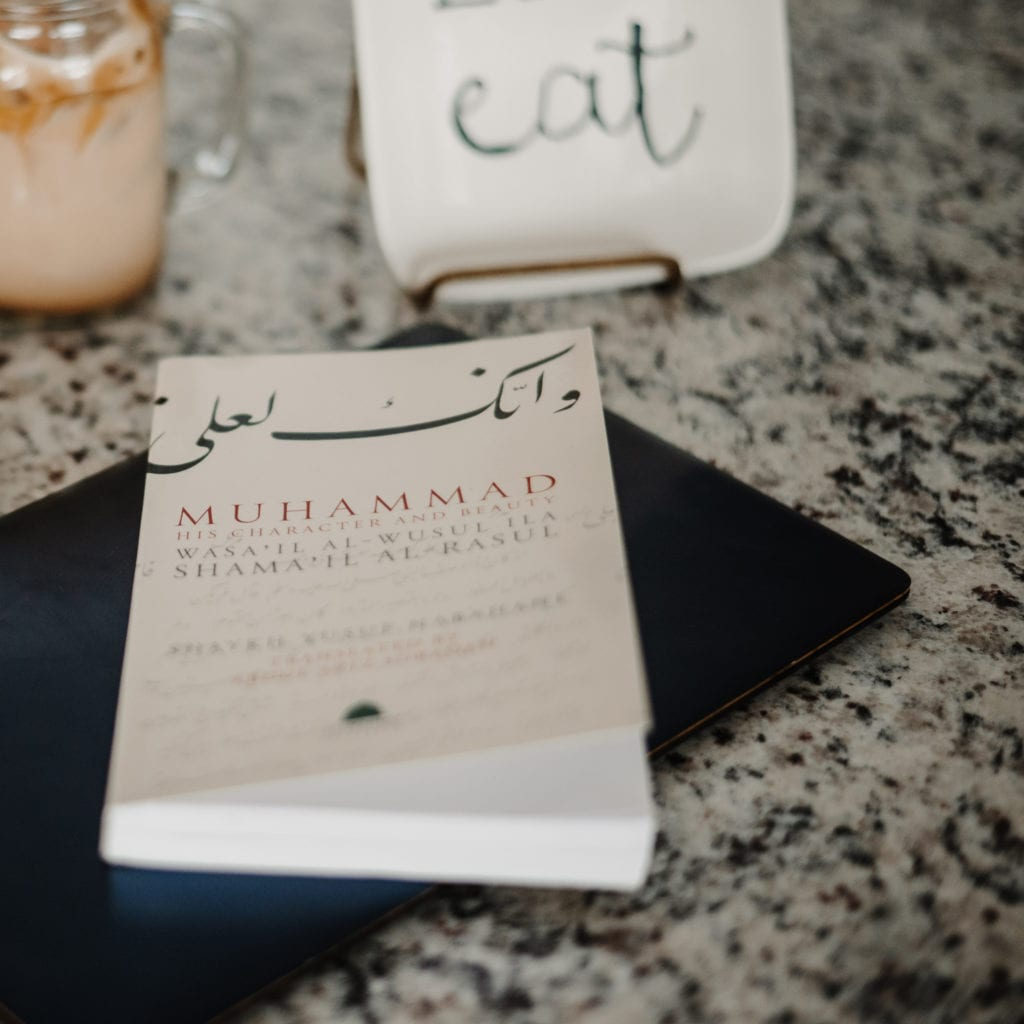 The book Muhammad His Character and Beauty on a kitchen countertop